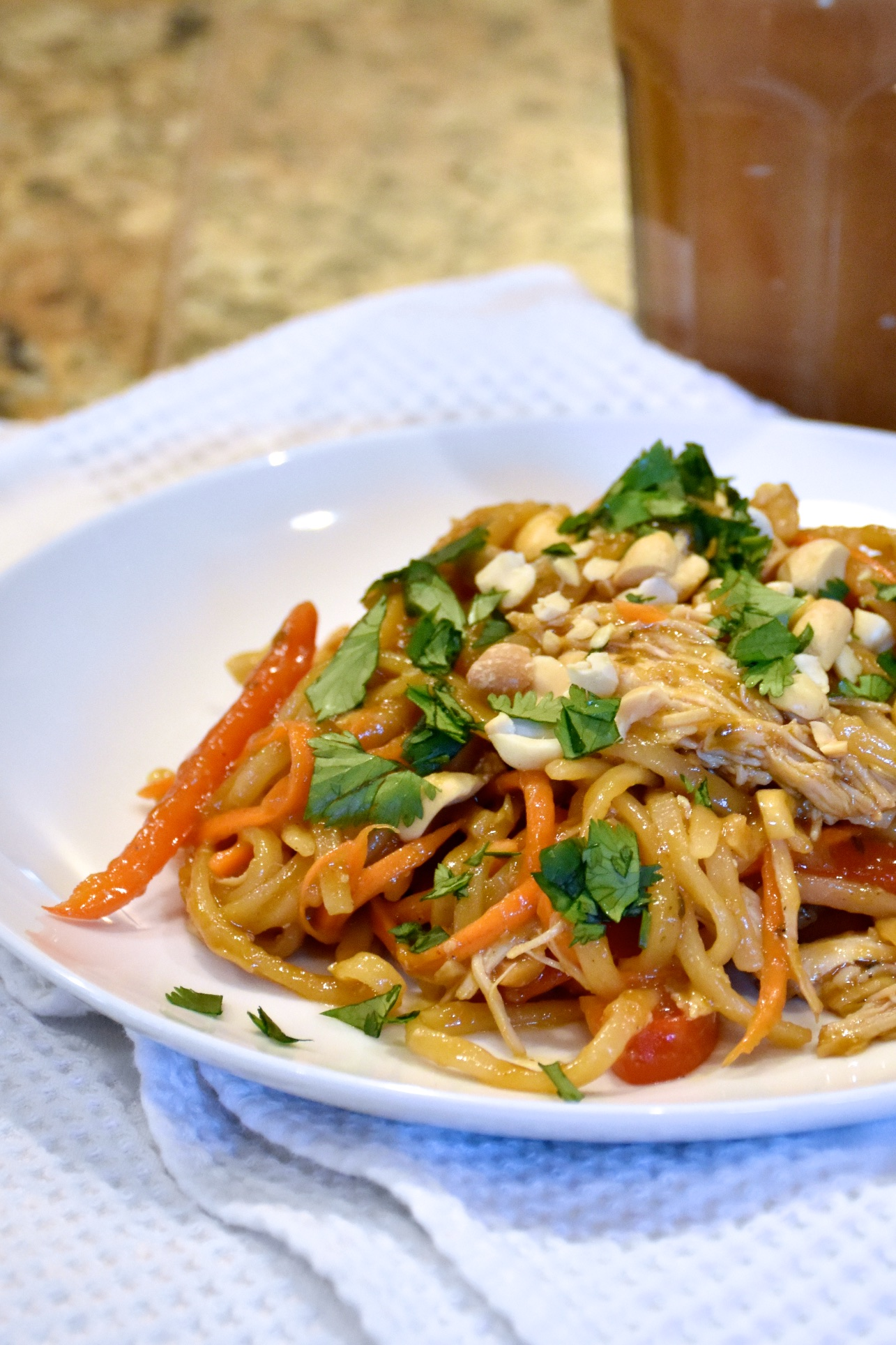 In the mood for Thai food but need it gluten-free? Try this Thai takeout-at-home Pad Thai recipe that is gluten-free and dairy-free. Click through for the full recipe.